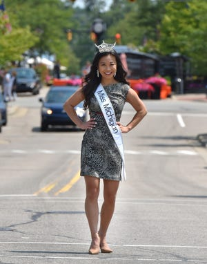 Northville native and Miss Michigan 2021 Vivian Zhong strikes a pose on West Main on July 22, 2021.