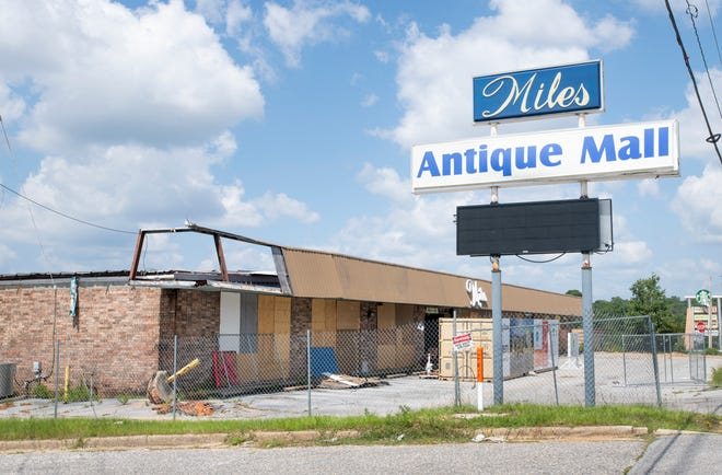 A sign announces a new Home2 Suites by Hilton coming soon to the location of the former Miles Antique Mall on Bayou Boulevard in Pensacola on Friday.