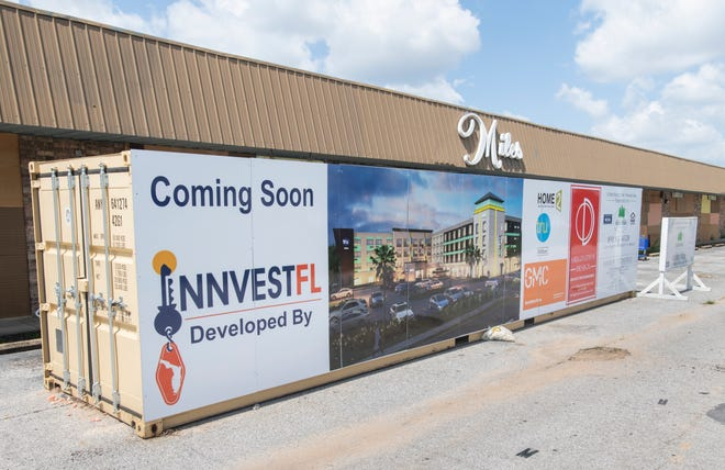 A sign announces a new Home2 Suites by Hilton coming soon to the location of the former Miles Antique Mall on Bayou Boulevard in Pensacola.