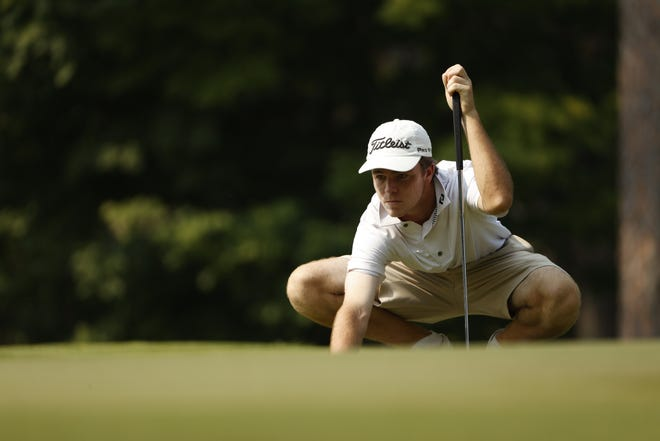 Luke Potter lines up his putt on hole seven during the round of 32 at the 2021 U.S. Junior at The Country Club of North in Village of Pinehurst, N.C. on Thursday, July 22, 2021.