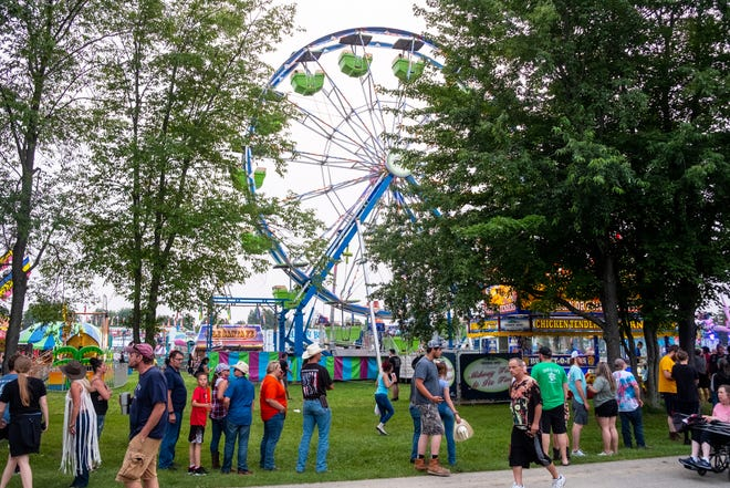 Crowds gather near food vendors and carnival rides Monday, July 19, 2021, at the St. Clair County 4-H and Youth Fair at Goodells County Park.