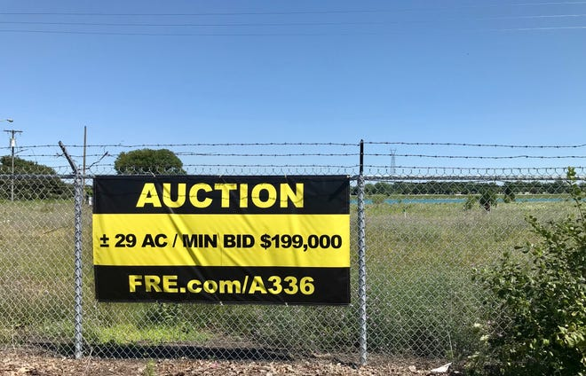 A sign lets people know the Mighty Marysville site at 301 Gratiot Blvd. in Marysville is up for auction on July 21, 2021.
