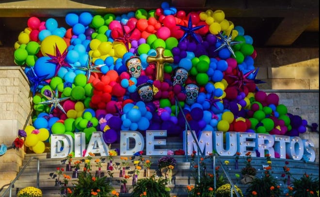 A Dia de los Muertos presentation is shown at a community altar on the steps of the San Angelo Museum of Fine Arts.