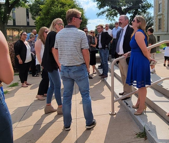 San Angelo attorney Leland Lacy talks to supporters while standing on the steps in front of the Tom Green County Courthouse on Thursday, July 22, 2021, after Lacy announced he will run for judge of the County Court at Law 2.