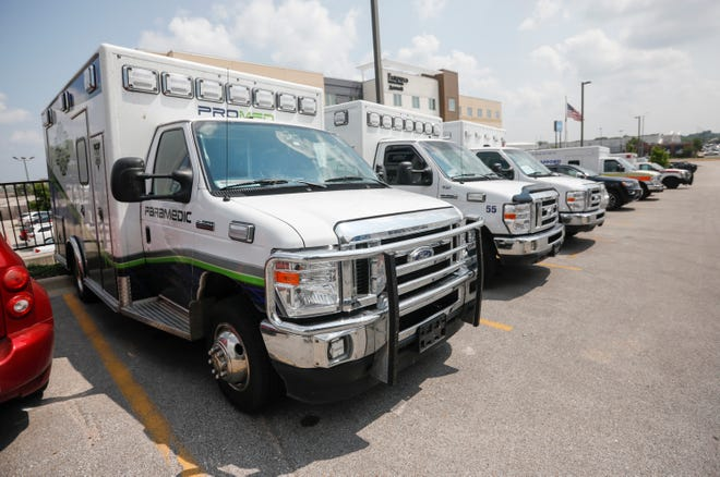 Ambulances are staged at the DoubleTree Hotel in Springfield on July 23, 2021. The ambulance teams, sent to southwest Missouri in response to a delta variant surge this summer, made over 200 trips in their first 13 days in the region.