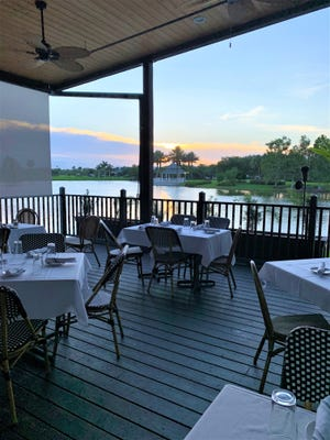 Alfresco dining on the patio at Meating Street Steak & Seafood provides a view of the water plus screens and fans to keep the heat at bay.