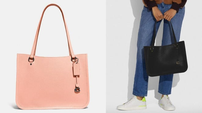 The decorative Coach charm adds a chic detail.