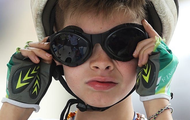 Cash Chappell of Providence, Ky., puts on his goggles and his game face Saturday as he readies for his rally stock race during the All-American Soap Box Derby in Akron.
