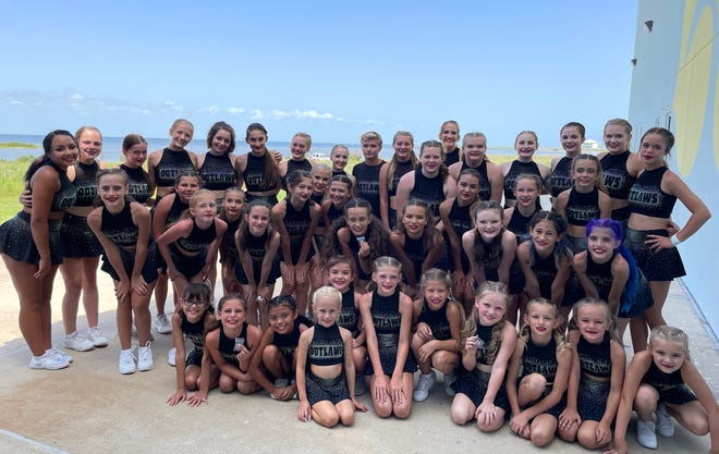 The Oklahoma Outlaws All-Star cheerleaders pose for a photo during the American Spirit Championship Summer Nationals in South Padre Island, Texas.