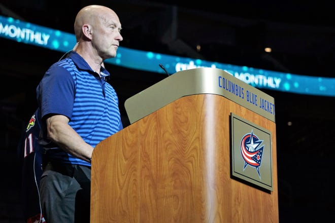 Blue Jackets general manager Jarmo Kekalainen prepares to announce one of the team's three first-round draft picks from Nationwide Arena.