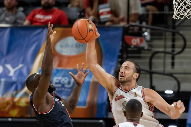 Carmen's Crew center Kosta Koufos blocks a shot from Mid American Unity's Demetrius Treadwell during a first-round win for the Buckeyes alumni squad. Koufos' presence marked a rare return to the OSU campus for him.