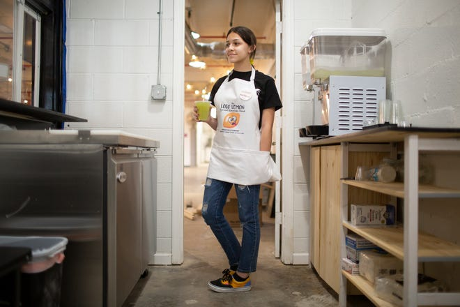 Annabelle Lockwood, 15, stands behind the counter of her newly-opened lemonade stand, the Loco Lemon, inside The Factory at Columbia on Friday, July 23, 2021.