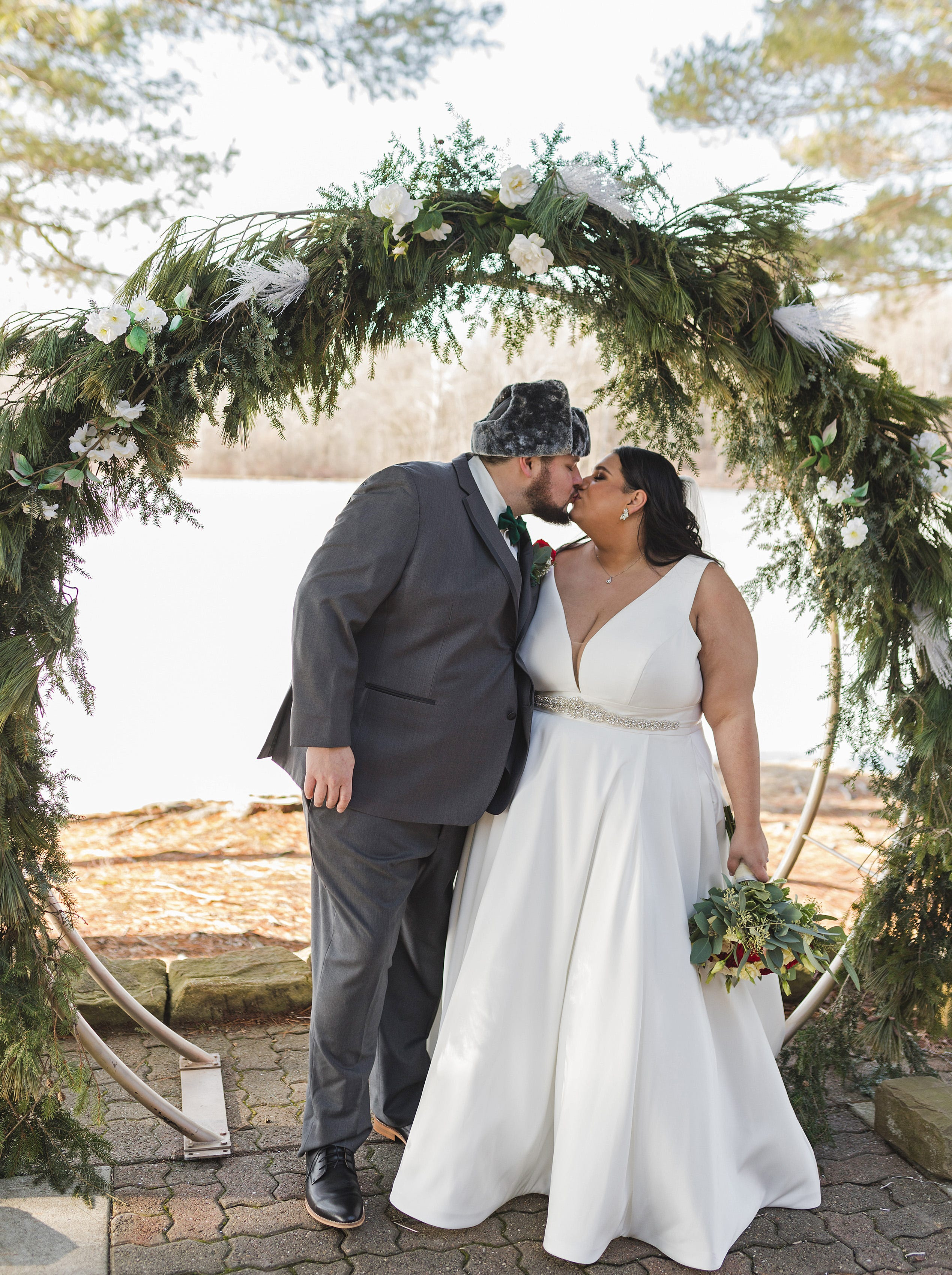 Ethan Walker, left, and Theresa Raydo, married, Jan. 9 at Mitchell Lake near Cambridge Springs. Walker, 28, of Hookstown, Beaver County, and Raydo, 27, of Millcreek Township, Erie County, were both adopted from Russia by different western Pennsylvania families.