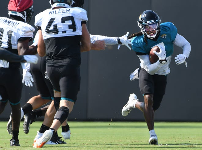 Jaguars CB/RS #7, Chris Claybrooks runs around defenders during kick return drills as the Jacksonville Jaguars went through practice in pads for the first time during training camp at the practice fields outside TIAA Bank Field Monday, August 17, 2020. [Bob Self/Florida Times-Union]