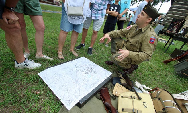 Reenactor Rick Smith talks about the 508th Parachute Infantry Regiment during the World War II Living History Day event held Saturday, July 24, 2021, outside of the Kings Mountain Historical Museum in Kings Mountain.