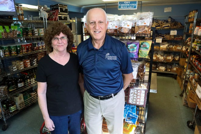 Co-owners Marie and Adib Salloum in the retail shop of the Mediterranean Market and Deli in downtown West Palm Beach.