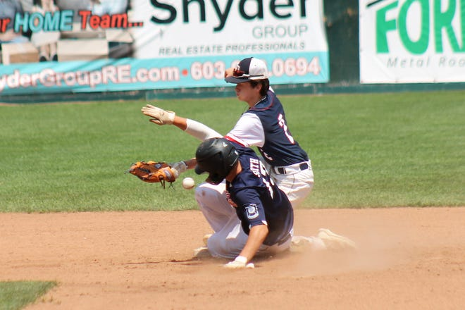 The baserunner and the ball arrive at the same time as Dover Post 8's JD Dalton tries to make a play on the sliding Zach Smith during Sr. Legion state tournament action Friday afternoon at Nashua's Holman Stadium.