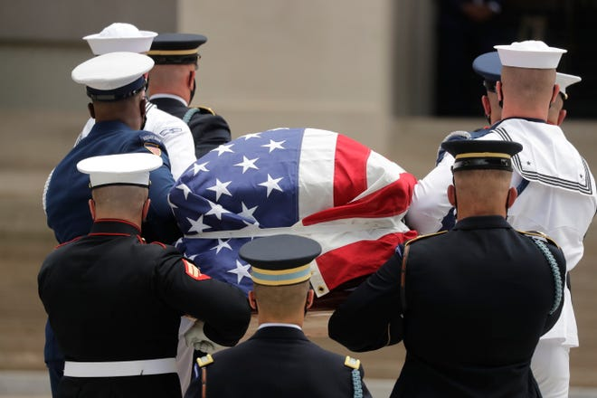 The casket of Rep. John Lewis is carried into the Georgia Capitol on July 29, 2020, in Atlanta. Lewis, who carried the struggle against racial discrimination from Southern battlegrounds of the 1960s to the halls of Congress, died July 17, 2020.