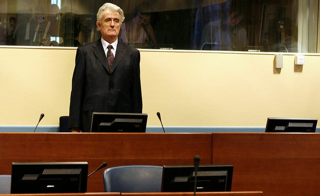 Former Bosnian Serb leader Radovan Karadzic, 63, stands in the courtroom during his initial appearance at U.N.'s Yugoslav war crimes tribunal in the Hague, Netherlands on July 31, 2008. He was extradited on July 30, 2008, to The Hague to face genocide charges after nearly 13 years on the run.