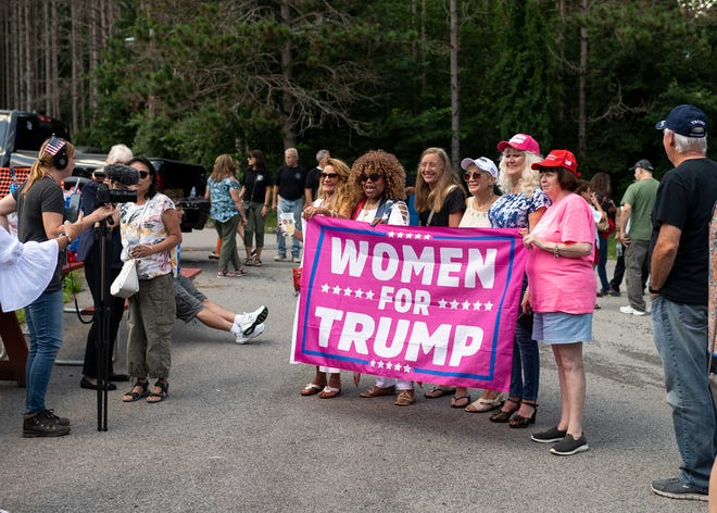Women gather during the 'Refounding Fathers Festival' held by the Super Happy Fun America group at the Century Sportsman's Club on Saturday in Auburn.