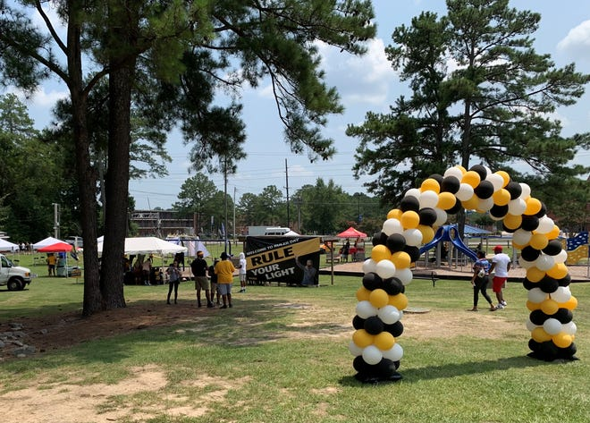 Crowds of people dressed in yellow gathered at Seabrook Park in Fayetteville on Saturday to celebrate Ruler Day in honor of Darius Jamar Dawson, who was killed in a car accident last September.