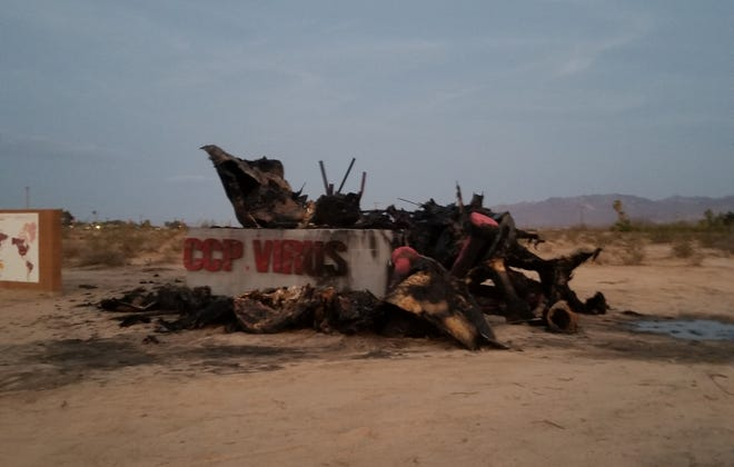 """""""CCP Virus,"""" a sculpture by artist Weiming Chen that once stood at Liberty Sculpture Park in Yermo, is seen destroyed in this undated photo."""