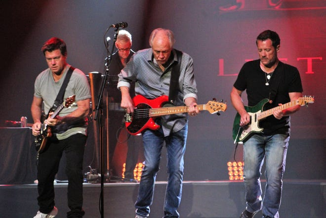From left, Rich Herring, Wayne Nelson and Colin Whinnery are in step during the Little River Band's performance Friday evening at the Abilene Convention Center. July 23 2021
