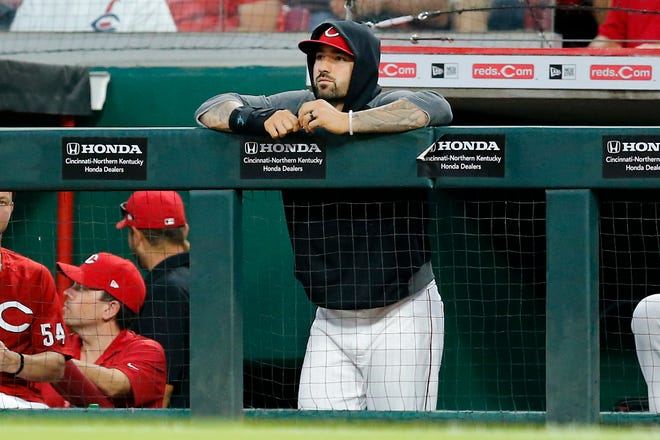 Injured Cincinnati Reds right fielder Nick Castellanos (2) watches from the dugout with a fractured hand in the fifth inning of the MLB National League game between the Cincinnati Reds and the St. Louis Cardinals at Great American Ball Park in downtown Cincinnati on Friday, July 23, 2021.