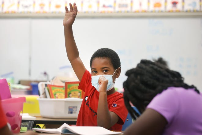 Cordarius Jones raises his hand to answer a question during summer learning academy at Treadwell Elementary School on Wednesday, July 21, 2021.