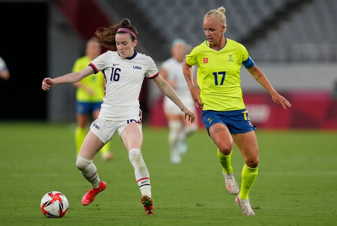 United States' Rose Lavelle, left, and Sweden's Caroline Seger battle for the ball during their Olympic match Wednesday.