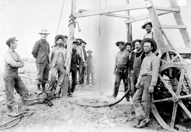 Workers in Coachella with artesian well.