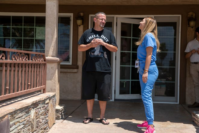 Robert Morin, 49, left, and Bella Monte Recovery Center Director of Nursing Vahida Tanovic-Lechuga talk at the recovery center in Desert Hot Springs, Calif., on July 22, 2021. Morin overdosed on heroin laced with fentanyl earlier this year.