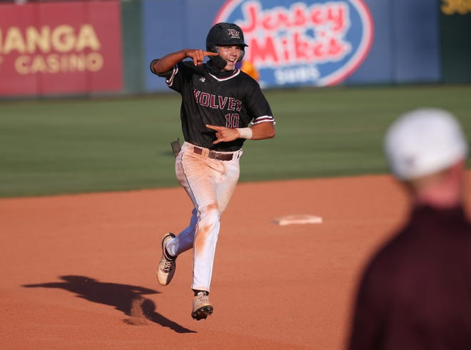 Desert Mountain's Wes Kath (10) celebrates after hitting a solo home run against Sunrise Mountain during the 5A baseball state championship game in Tempe, Ariz. May 17, 2021.