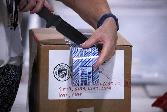The audit of Maricopa County's ballots from the 2020 general election continues on July 24, 2021, in the Wesley Bolin Building at the Arizona State Fairgrounds in Phoenix, Ariz.