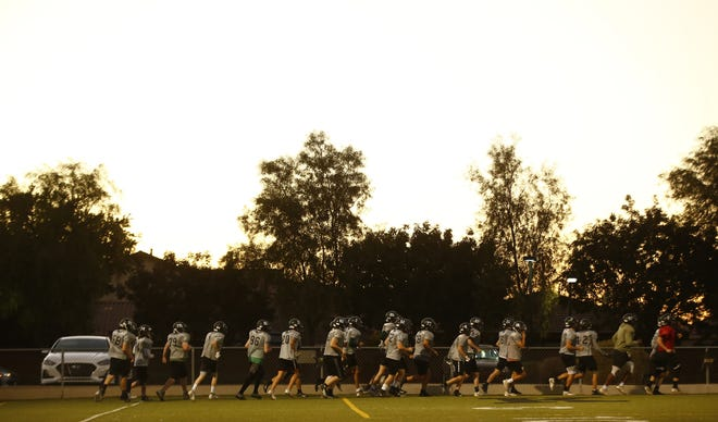 Gilbert Christian warms up before practice at Gilbert Christian High School in Gilbert, Ariz. on Nov. 16, 2020.
