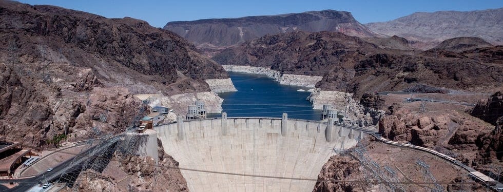 A high water mark is visible on the shoreline of Lake Mead at Hoover Dam.
