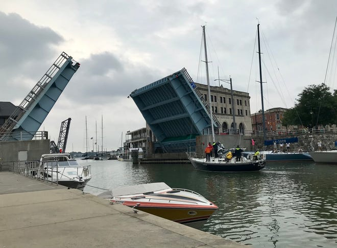 Boats pass under the Military Street Bridge on their way to the St. Clair River for the start of the 2021 Bayview Mackinac Race in downtown Port Huron on July 24, 2021.