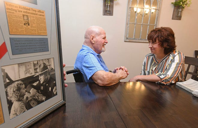 Retired Richland Townhip (Cambria County) police officer Tony Palm is reunited with Bernie Imgrund, of Bedford, PA., after a 50-year absence, in Johnstown, Pa., Monday, July 19, 2021. Imgrund was accidentally left behind on a family shopping trip to Gee Bee's department store in Johnstown in 1971, when Palm responded to the incident, and consoled the her until he could reconnect her with family later that day. (John Rucosky/Tribune-Democrt via AP)