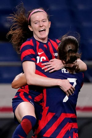 Team United States midfielder Rose Lavelle (16) celebrates with forward Tobin Heath (7) after scoring a goal during the first half against New Zealand in group G play during the Tokyo 2020 Olympic Summer Games at Saitama Stadium.
