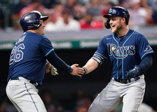 Tampa Bay Rays' Austin Meadows, right, is congratulated by Ji-Man Choi after Meadows hit a two-run home run in the ninth inning of the team's baseball game against Cleveland, Saturday, July 24, 2021, in Cleveland. (AP Photo/Tony Dejak)