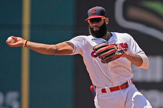Cleveland's Amed Rosario throws out Tampa Bay Rays' Randy Arozarena at first base in the fifth inning of a baseball game, Sunday, July 25, 2021, in Cleveland. (AP Photo/Tony Dejak)