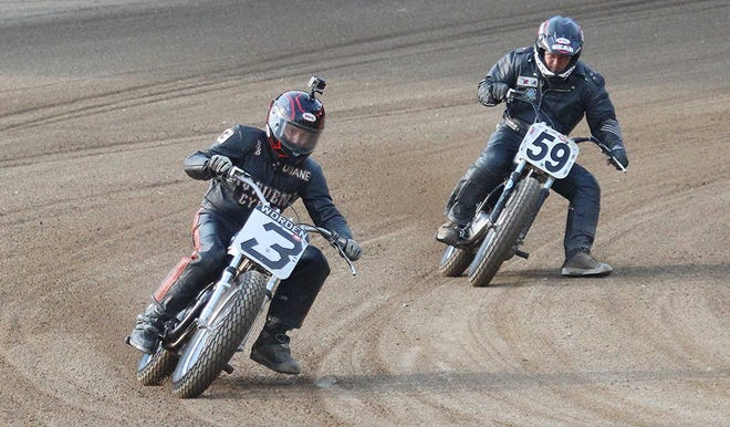 AMA Vintage Motorcycle racers Duane Worden, left, from Canal Fulton, makes his pass around turn 4 on his Yamaha 450 cc class in front of Tim Ferguston of Wyalusing, Pennsylvania, on Saturday at the Ashland County Fairgrounds.