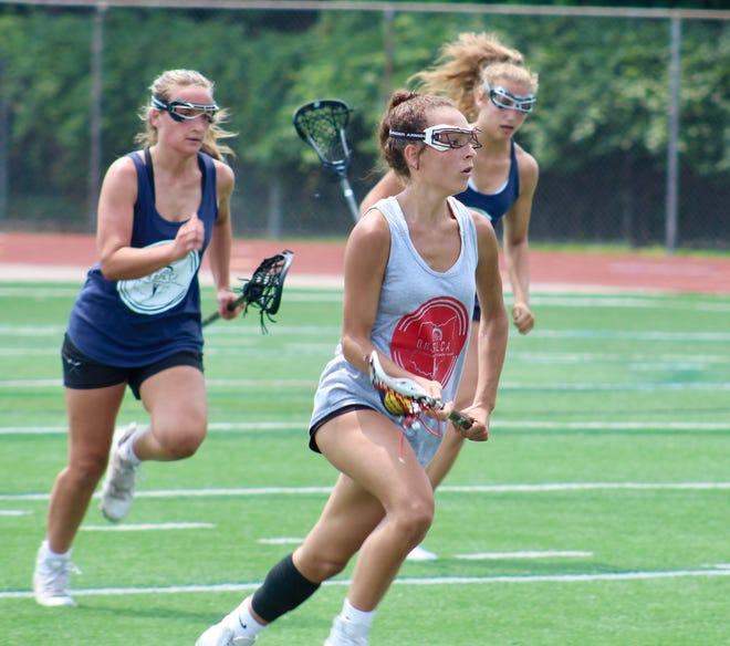 Iroquois' Bella Avila advances the ball during an Ohio High School Girls Lacrosse Coaches Association state all-star game July 24 at Worthington Kilbourne. Avila is a 2021 graduate of Thomas Worthington. Iroquois beat Wyandot 17-8.