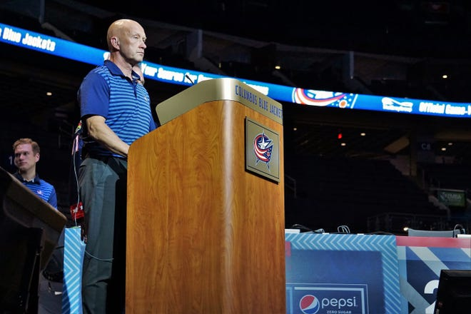 Blue Jackets general manager Jarmo Kekalainen prepares to announce one of the club's nine 2021 draft picks from the floor of Nationwide Arena.