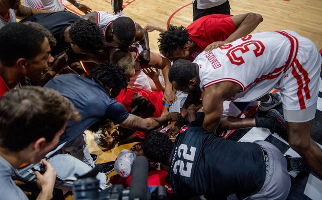 Players and fans mob Marcellus Sommerville of Always A Brave after he sunk the game-winner over Chicago Hoopville Warriors in the first round of The Basketball Tournament on Saturday, July 24, 2021 at Carver Arena in Peoria. Always A Brave advanced with a 75-73 victory.