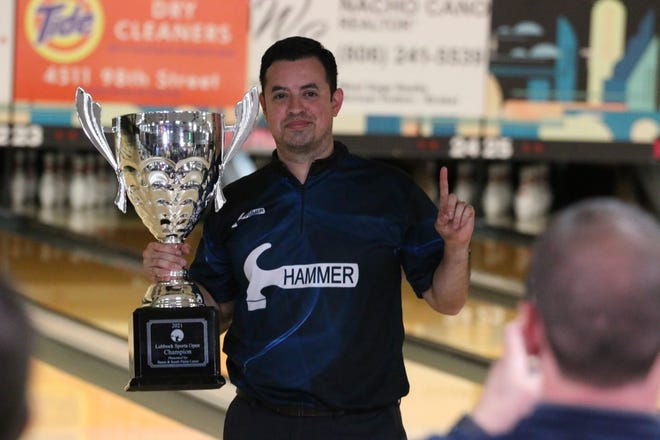 Houston bowler Shawn Maldonado poses with the trophy cup after winning the PBA Lubbock Sports Open on Sunday at South Plains Lanes. It was the second career PBA Tour national title for Maldonado.