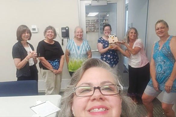 A group of women met at the Pratt Public Library last week to work their way through the first-ever escape room offered there. Successfully completing the puzzle were (from left) Lea Ann Holland, Louise Pelzl, Debby Blatchley, Abigail Skiles, Marsha Barker, Tammy Killough, and (in the foreground) Derese McAbee.