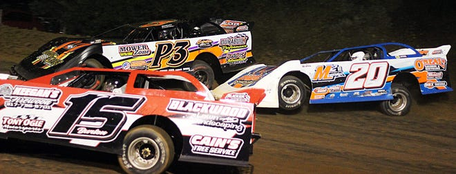 Steve Peeden (P3) leads his brother-in-law, Tyler Neal (20) as they battle for the lead while lapping another car during the feature race for the Indiana Late Model Series on Friday at Paragon Speedway.
