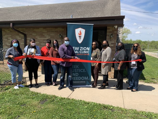 The Rev. Ken Copeland of New Zion Missionary Baptist Church cuts the ribbon in May 2021 for opening the New Zion Legal Clinic housed in the church at 4747 W. Riverside Blvd.