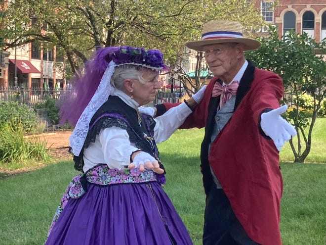 """Shirley and Larry Hackmann of Washington, Ill. and members of the Central Illinois Civil War Ballroom dancers perform a two-step dance on the lawn of the Old State Capitol in downtown Springfield. The 33rd Illinois Volunteer Regiment Band played at the capitol Saturday evening as part of History Comes Alive. The volunteer regiment was known as the """"Teacher's Regiment"""" because it was formed from many college students on the campus of the Illinois State Normal School, now Illinois State University. The regiment formally organized at Camp Butler in 1861."""
